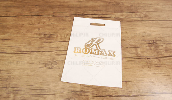 چاپ ساک تبلیغاتی طلاکوب فروشگاه رومکس